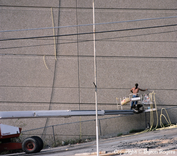 Man working on wall Austin Photograph